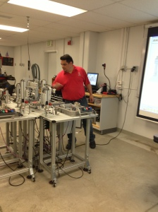 Machining Laboratory. March 5, 2013.Manny Fernandez demonstrating the workings of a manufacturing plant.