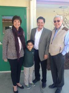 barbara grim, the principal, jim young and a student