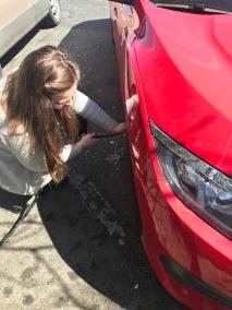 Lesley Bonds checking her tire pressure