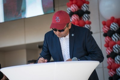 Adam Alvidrez signing the Kern Promise with the BC hat