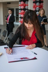 Sonya Christian signing The Kern Promise