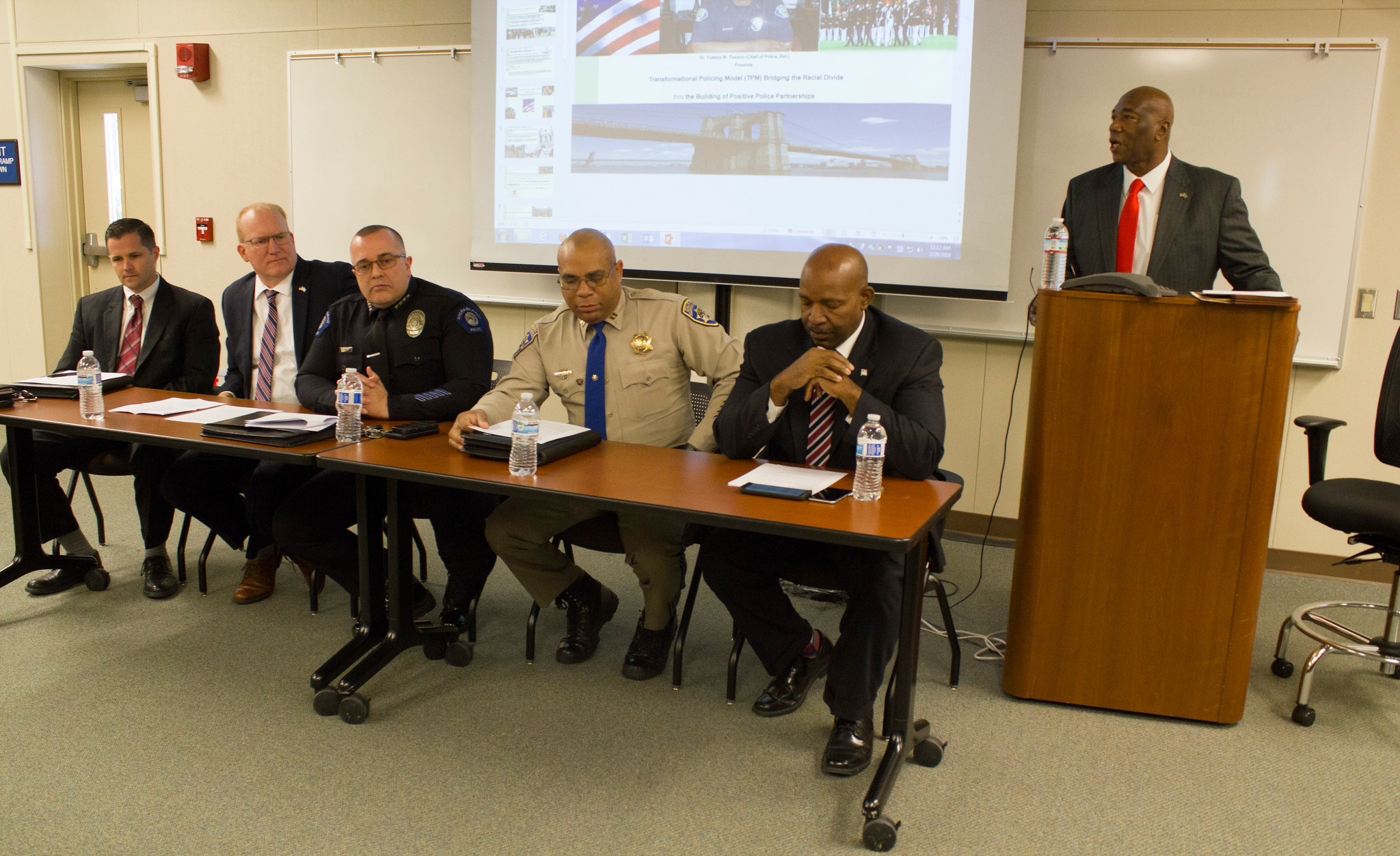 left to right FBI Special Agent Bennett O. Scott, Kern County Assistant District Attorney Scott Spielman, McFarland Police Department Chief Scot Kimble, CHP Commander Ron Seldon, Bakersf