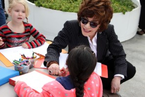Lynda Resnick drawing with the children