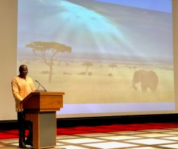 Andrew Kamiti on stage during presentation