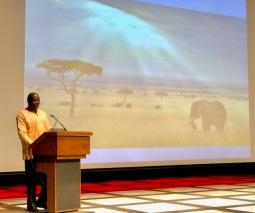 Andrew Kamiti on stage during presentation