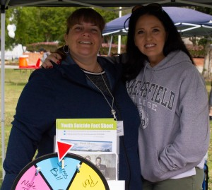 Teena Bensusen (left) and Amber Smithson from the Behavioral Health Hospital host a booth at the Renegade Pulse Health Fair on April 18th.