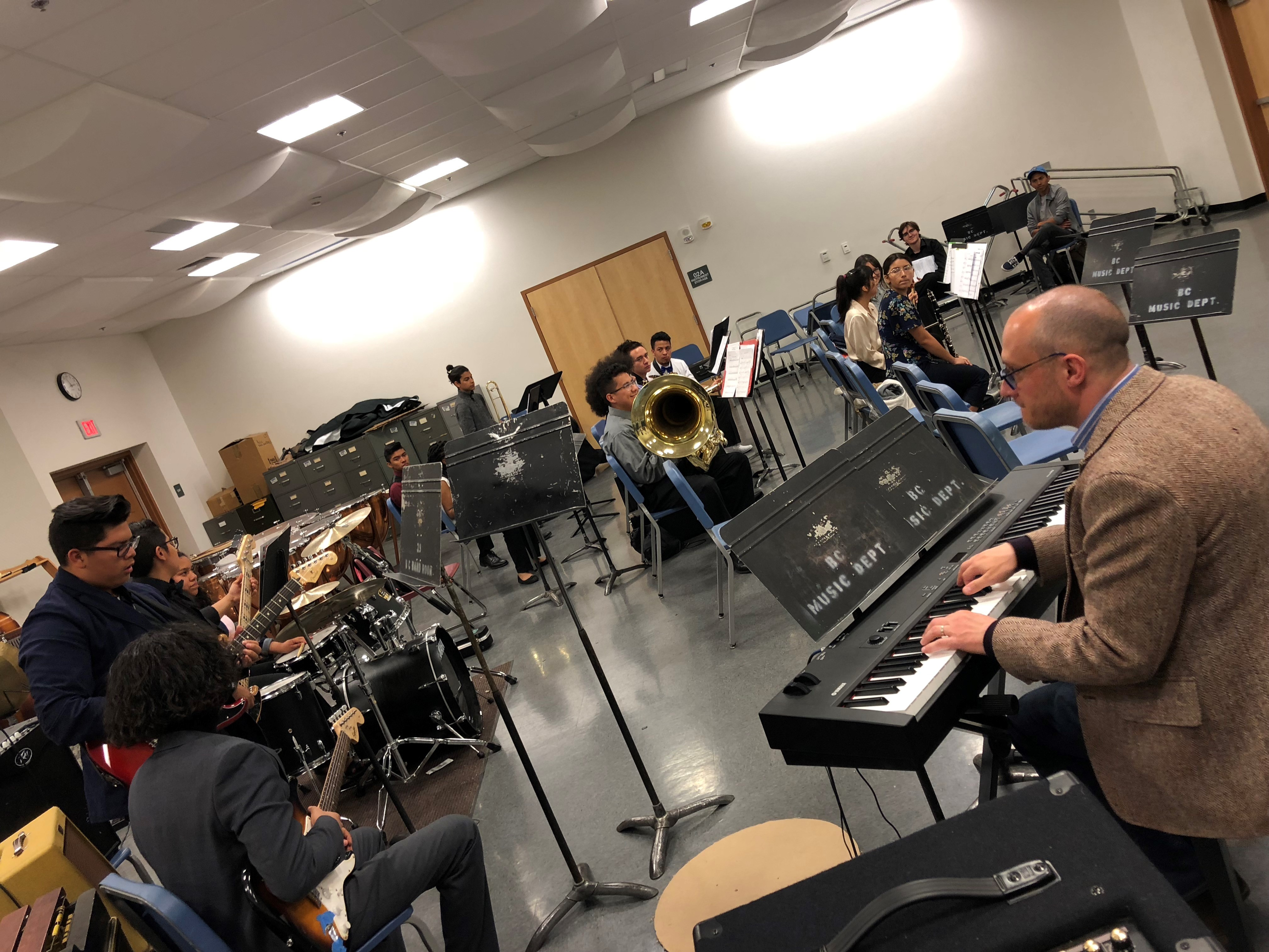 Head clinician Adam Benjamin works with students from Mira Monte High School