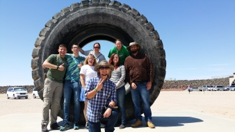 geology club in huge hauler tire at Borax mine