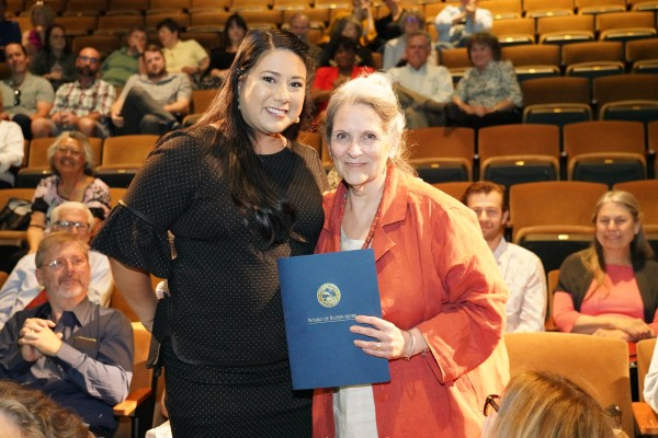 Nan Gomez Heitzeberg with Resolution from Board of Supervisors
