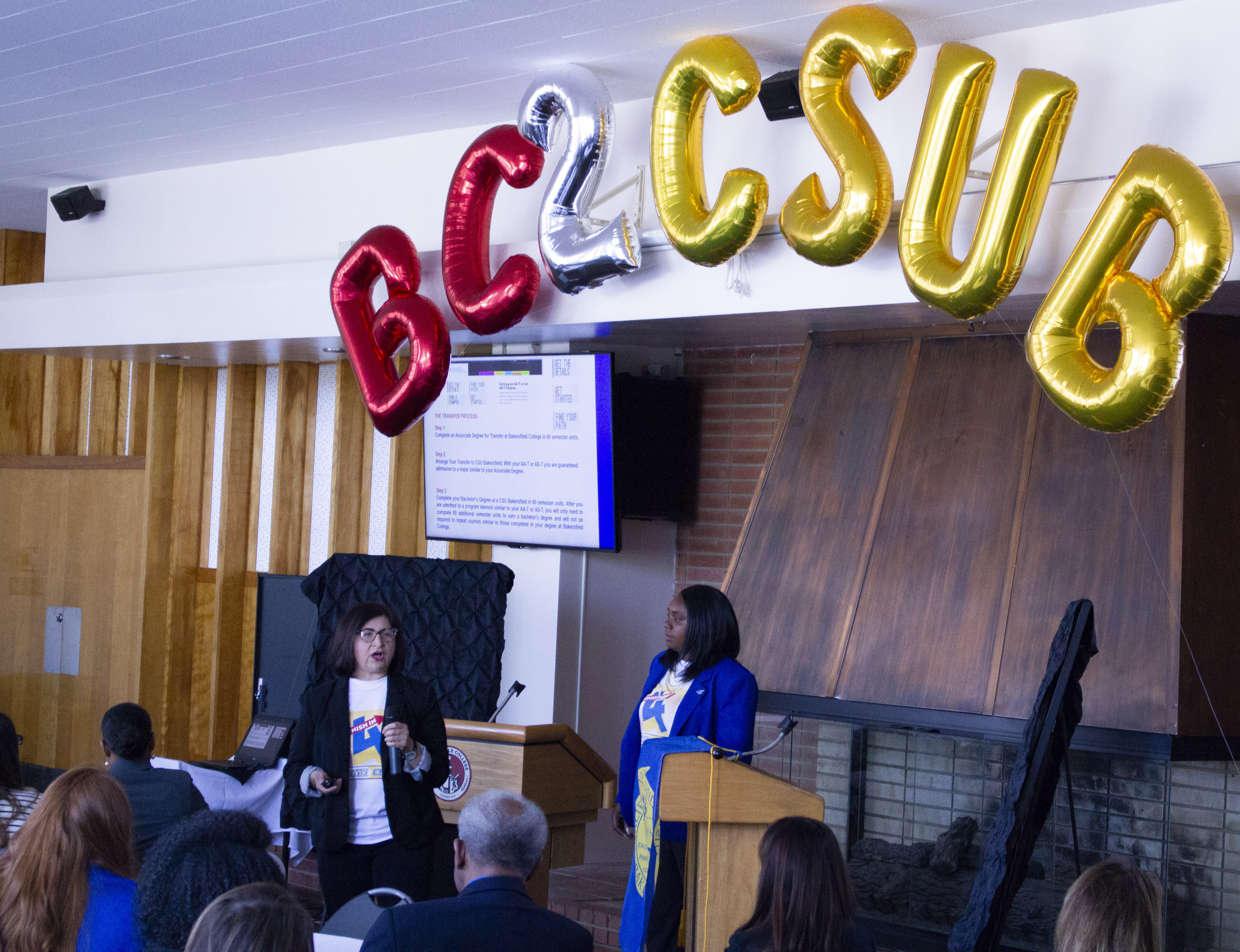 BC 2 CSUB balloons over speakers from BC and CSUB