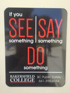 if you See something Say Something Do Something public safety sign
