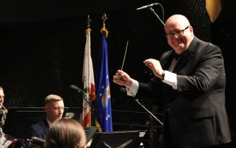 Michael Stone, the Bakersfield City School District's Coordinator of the Visual and Performing Arts, guest conducting the band.