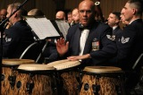 Staff Sergeant Freddie Cruz playing bongo drums