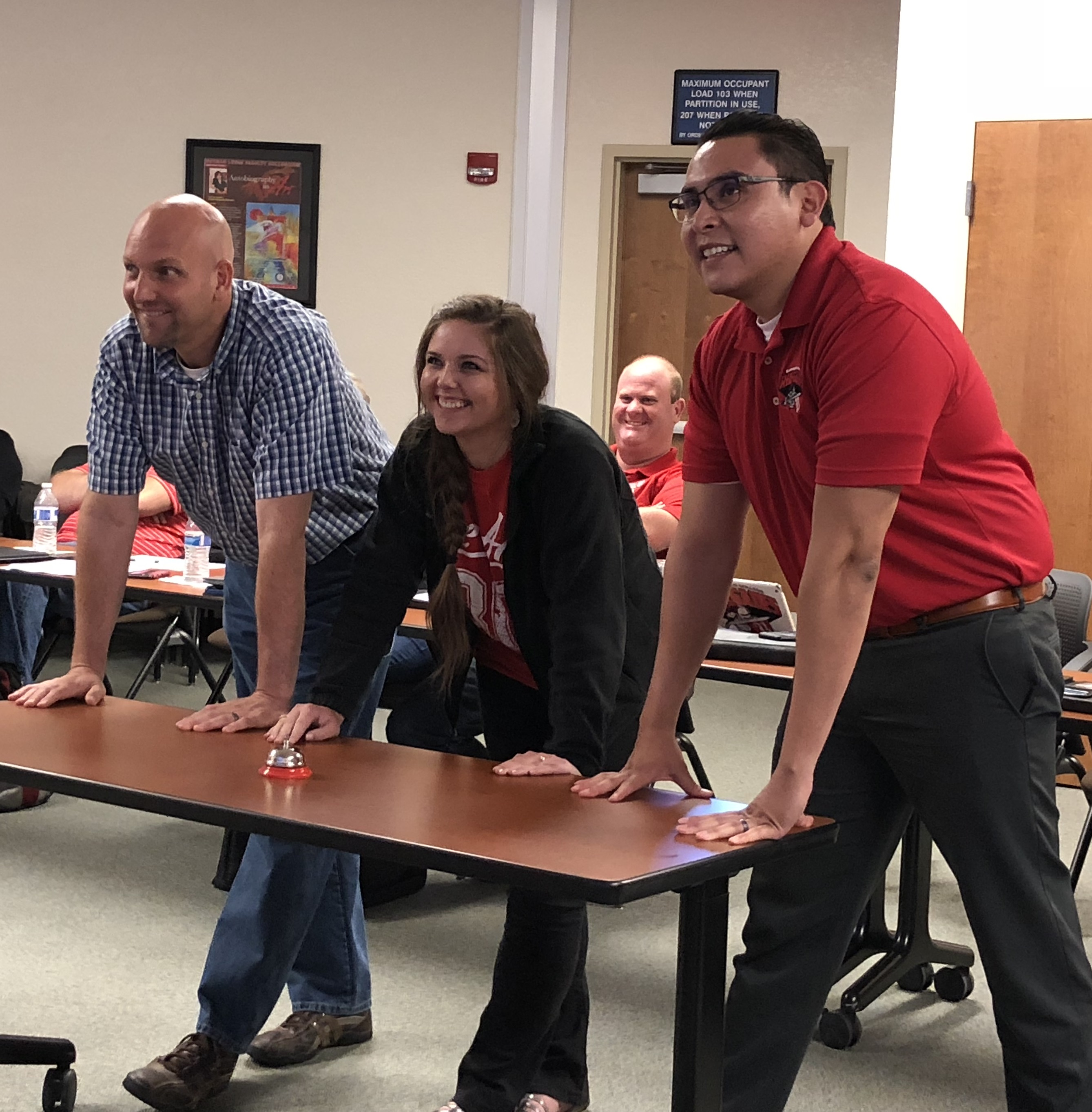 Todd Coston, Lesley Bonds, Abel Guzman participating in a game a jeopardy organized by Manny at Cabinet June 4 2018