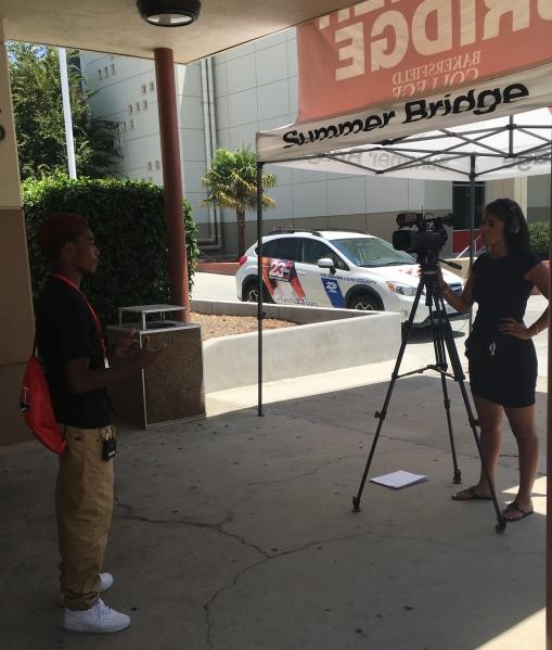 Tori Cooper interviewing student