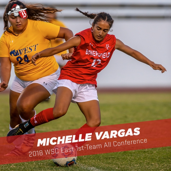 Michelle Vargas running the ball with the opposing team on her trail
