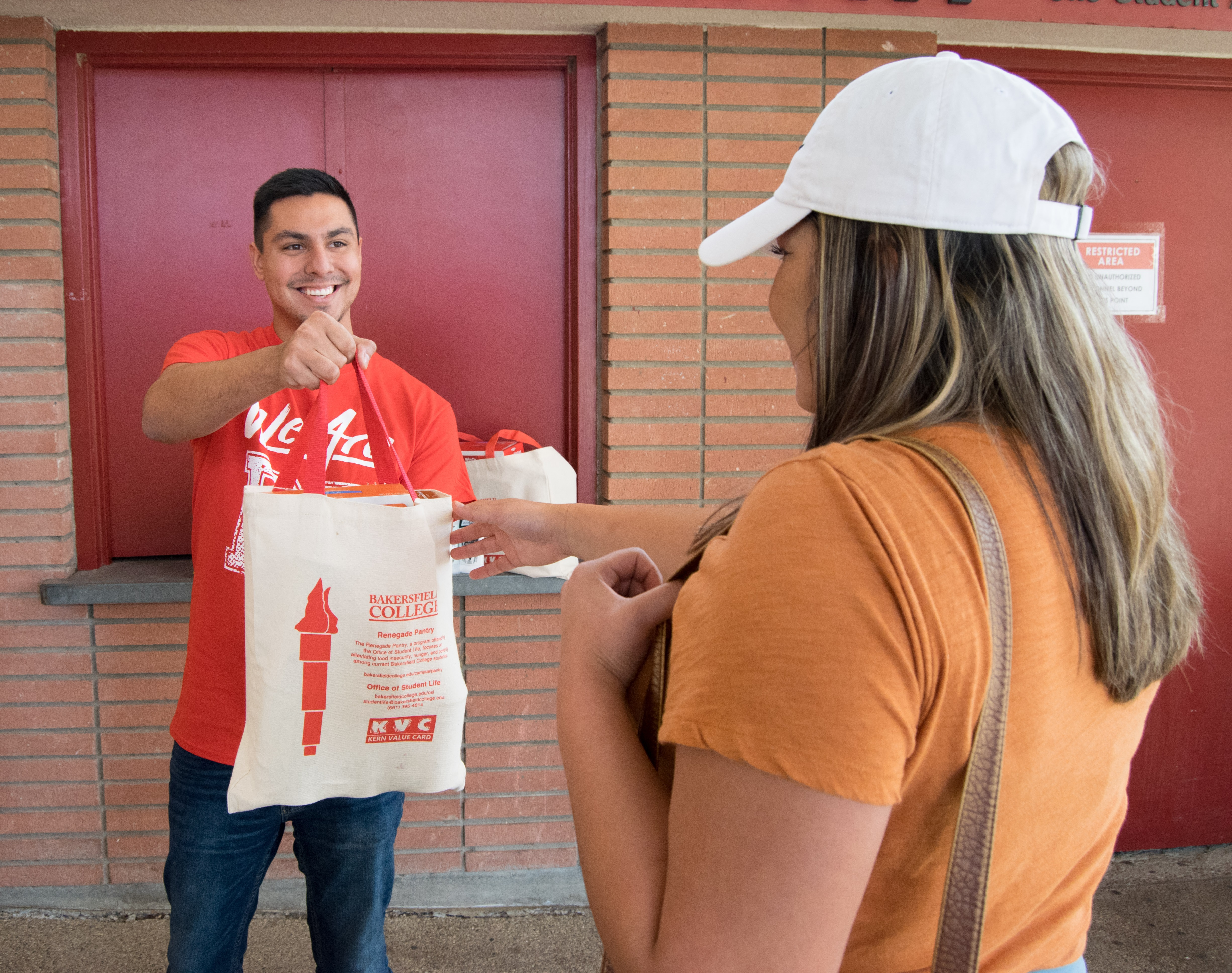 Student hands out Pantry bags