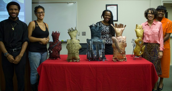 Umoja students and faculty with the author and 5 dolls made from repurposed clothing