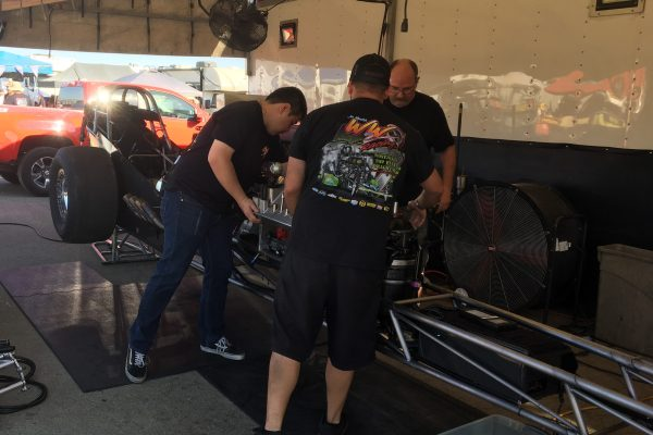 Mechanics working on race car