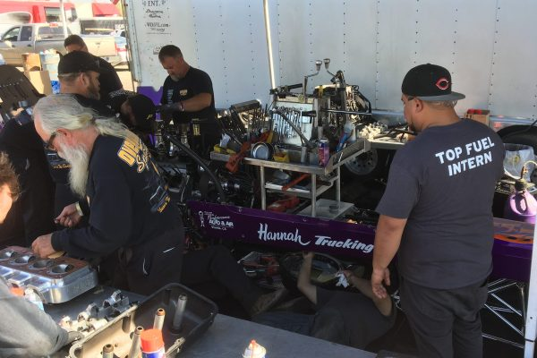 Mechanics working on engine