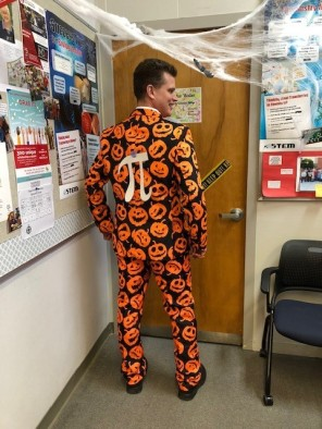 Jon Brown in a pumpkin covered suit with the Pi symbol on back