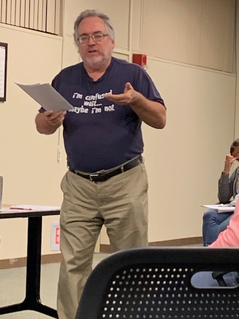 """speaking while wearing a t-shirt that says """"I'm confused, wait... maybe I'm not."""""""
