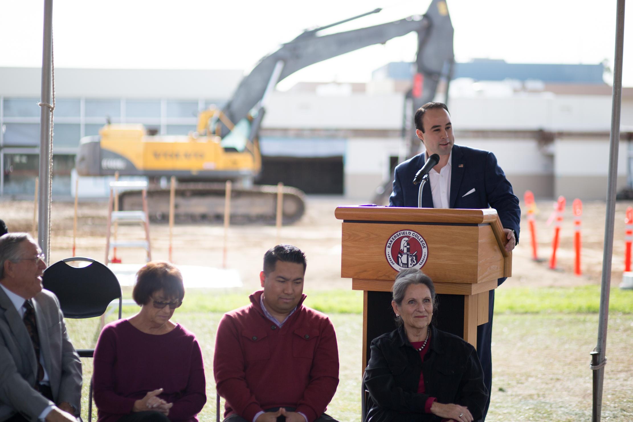 former BCSGA president Alex Dominguez speaks at the podium