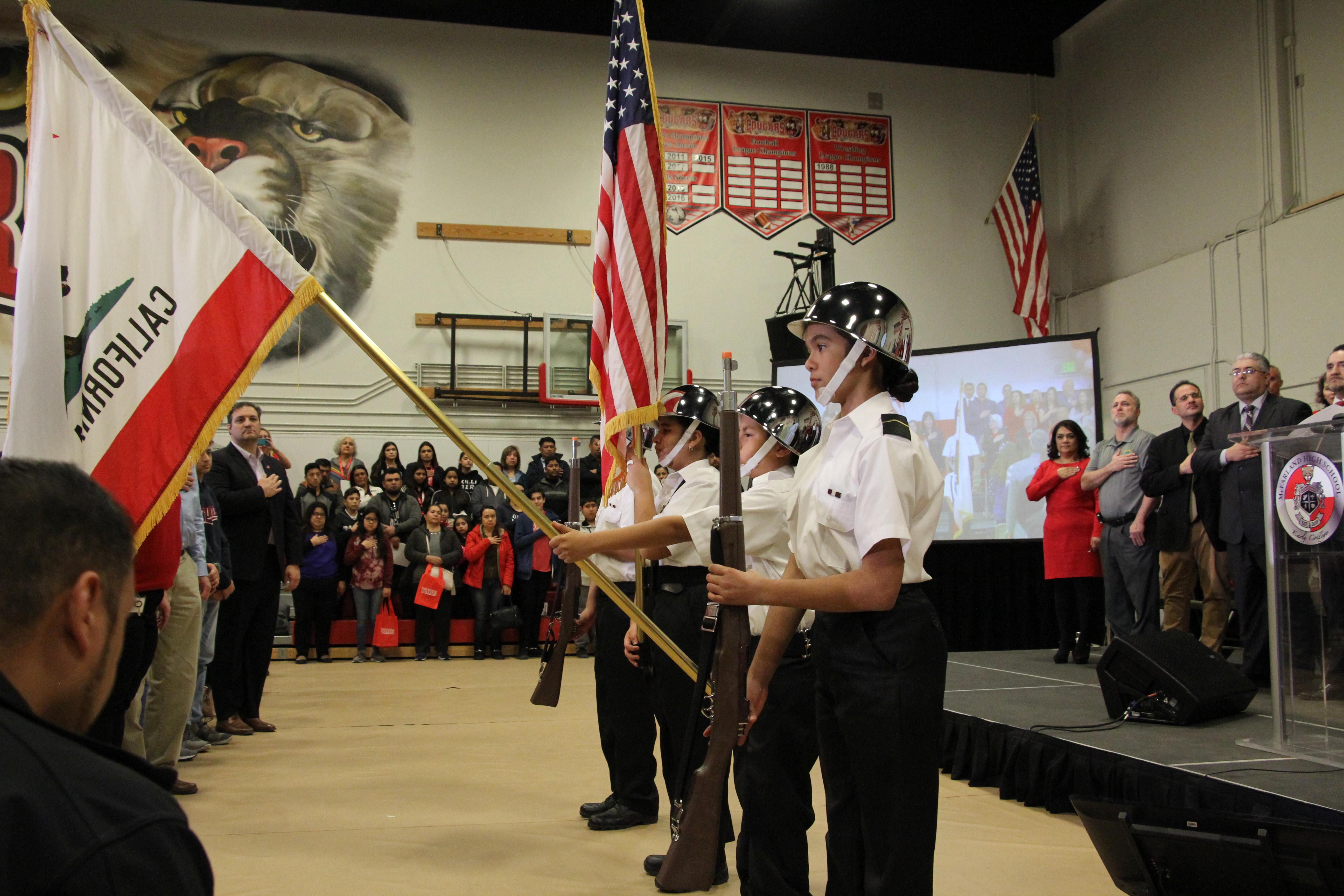 McFarland children holding flags