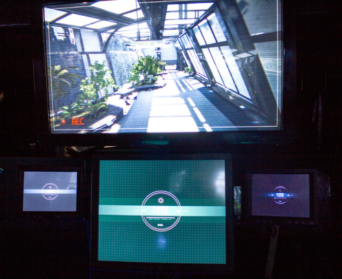 A simulation of the Search and Rescue Automation Hardware (SARAH) system is displayed inside the US Army STEM Truck.