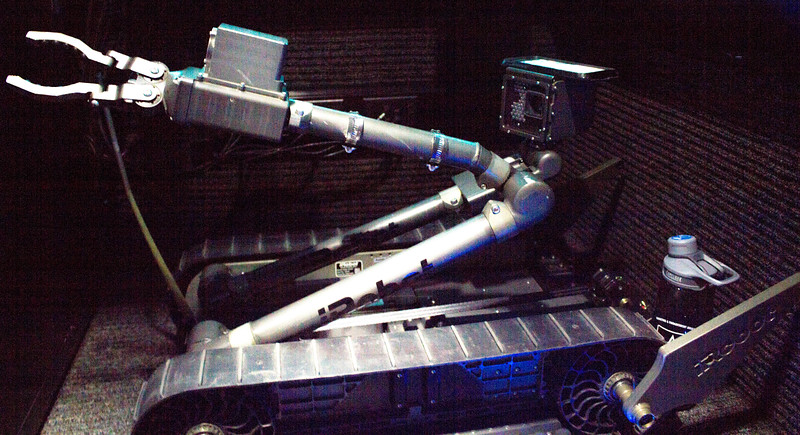 An iRobot drone used to remotely disarm explosives is displayed inside the US Army STEM truck.