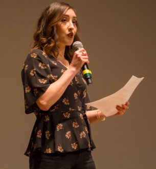 Woman on microphone.