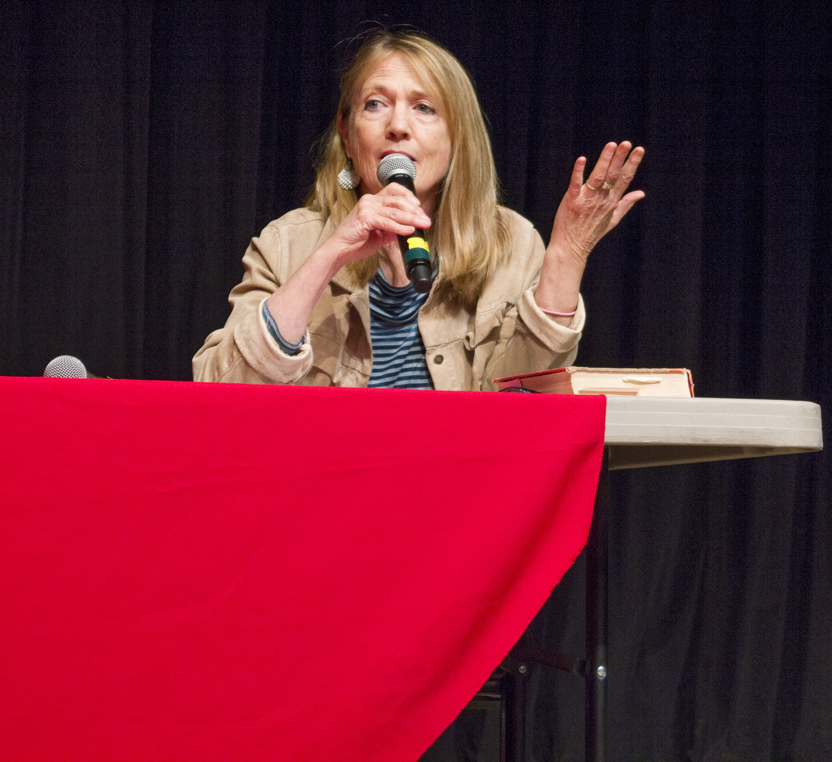 Woman speaking into microphone.