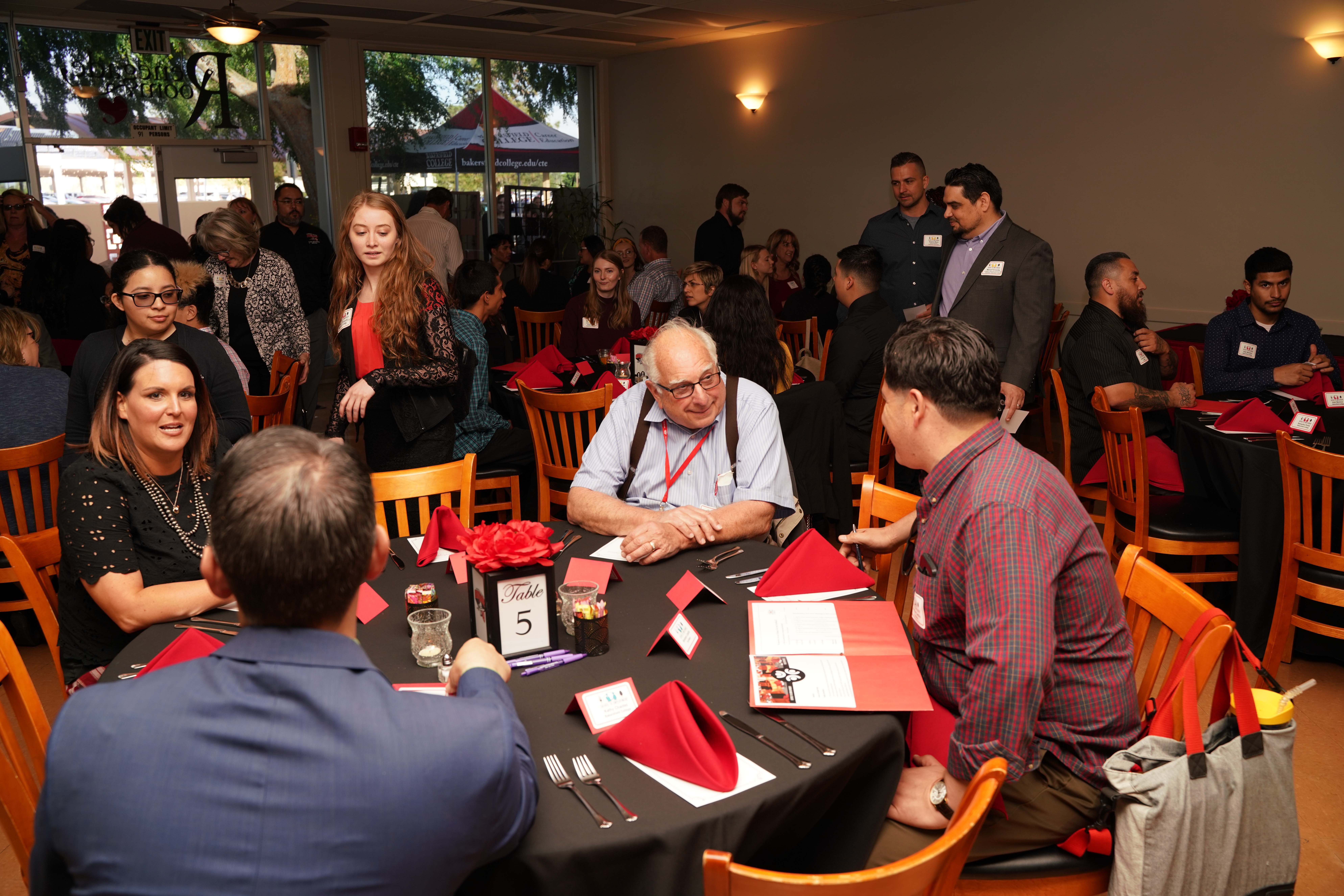 Guests at the dinner table for the Entree to Employment event