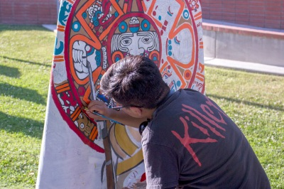 Male painting aztec head