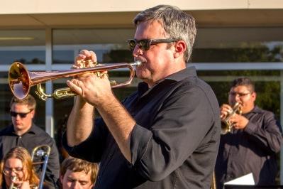 Man blowing trumpet