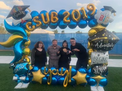 Group poses in a balloon frame with Congrats CSUB 2019 yay!