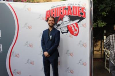Male in front of the Renegades backdrop.