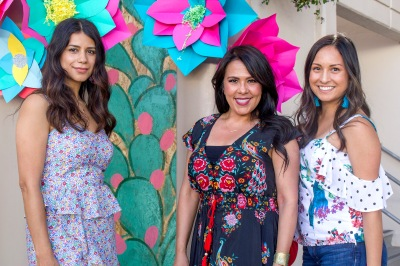 three women in floral prints smiling