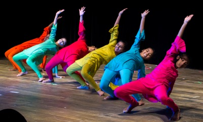 Dancers in colorful costumes.