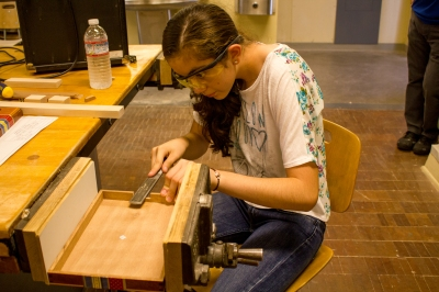 Student filing her cigar box.