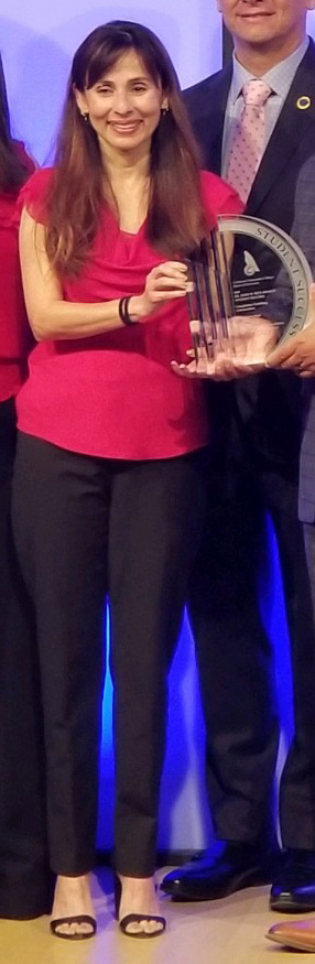 Sonya holding the Student Success award.