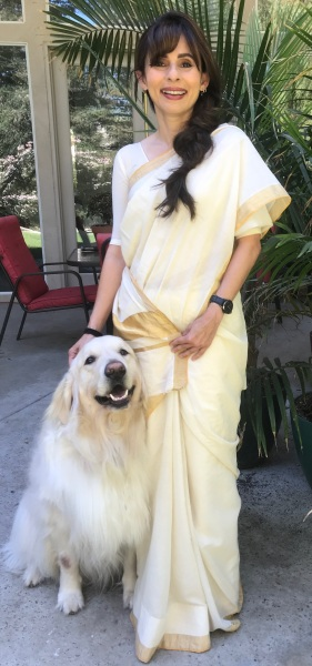 Sonya poses with Golden Lab Neo.