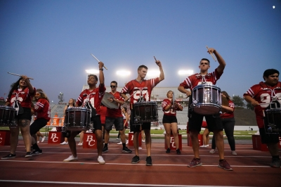 Drumline playing in sync.