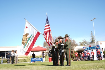 4 uniformed men with the CA and US flags.